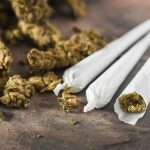 southcoastcounseling-how-long-does-marijuana-stay-in-your-system-photo-of-marijuana-joints-buds-on-stone