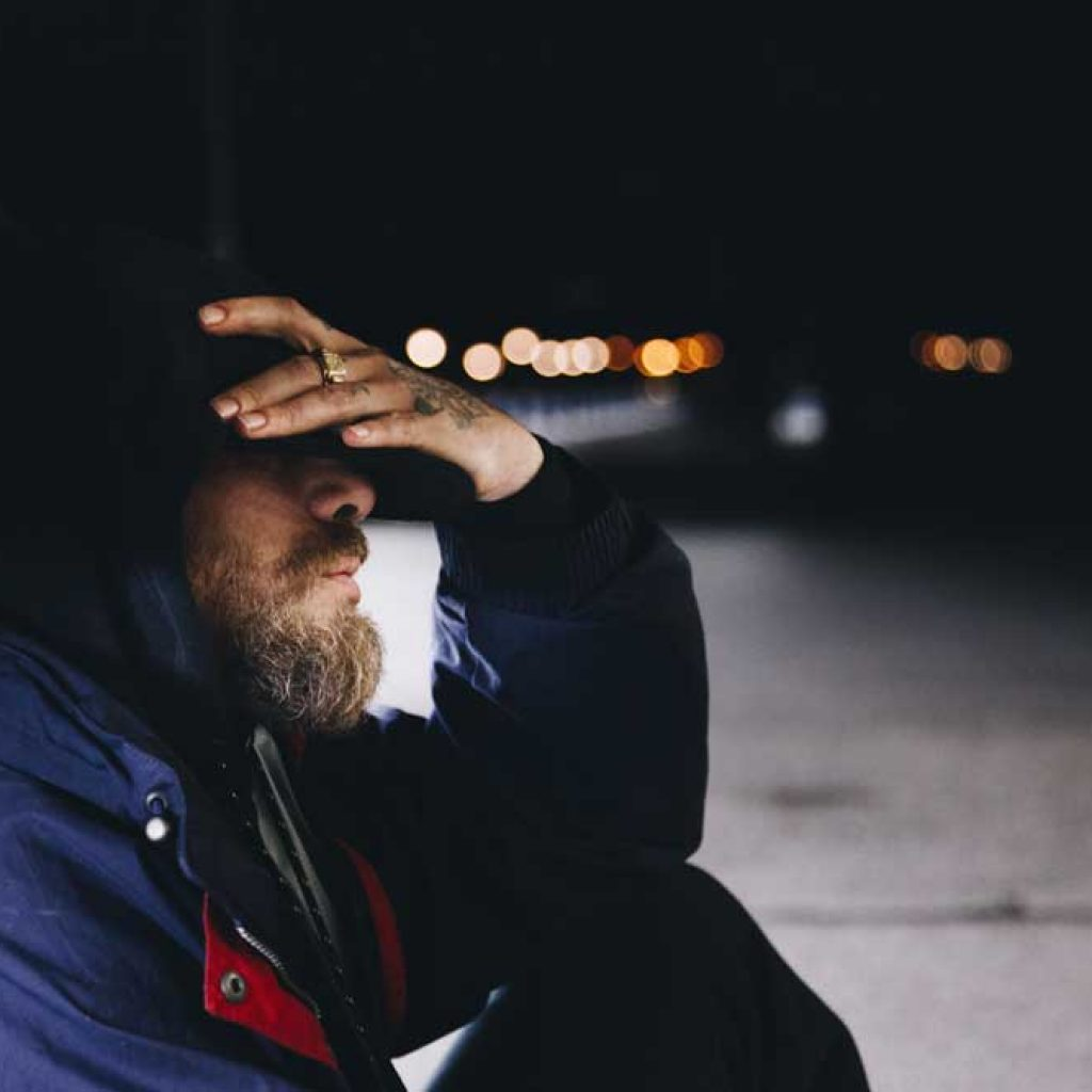 southcoastcounseling-ptsd-and-addiction-photo-of-a-lonely-man-sitting-on-the-street